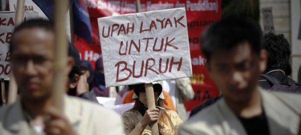 Upah dan Sanksi Pidana Dalam Politik Hukum Perburuhan Indonesia